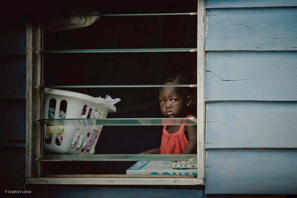 Little Girl in Window | Photo: Harvey Lisse
