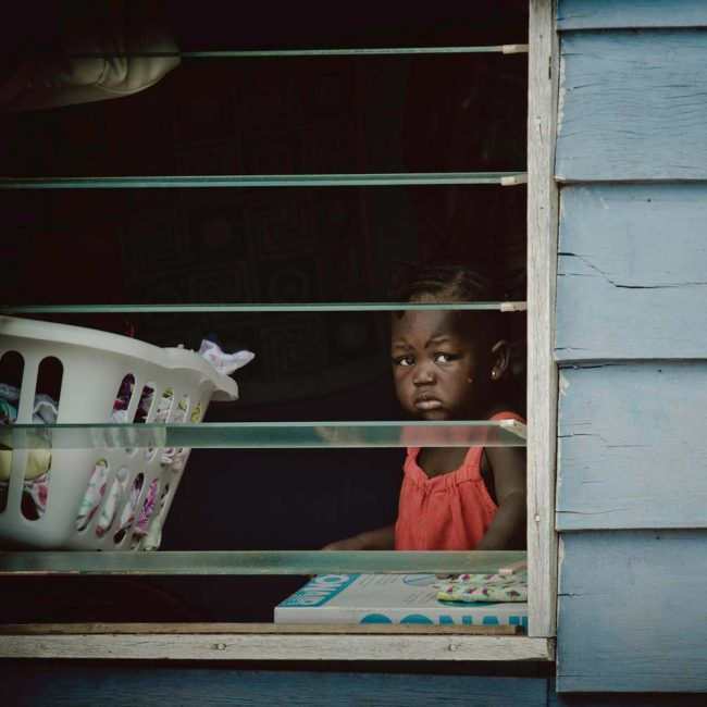 Little Girl in Window | Photo: Harvey Lisse