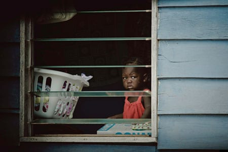 Little Girl in Window by Harvey Lisse